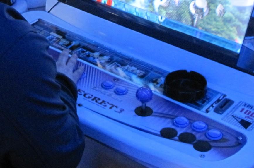 Me, playing an arcade machine in a Taito arcade in Akihabara