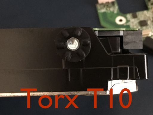 A photo showing the Torx T10 screw that attaches the bumper to the drive