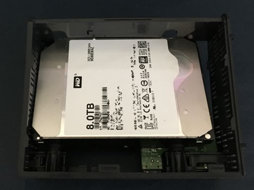A photo of the drive angled out of the shell from the label side