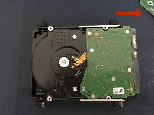 A photo of the drive with the USB interface removed, and the direction in which to remove it